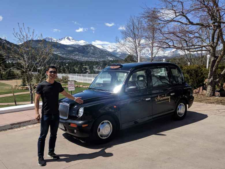 Felix Wong in front of a London Taxi at the Stanley Hotel in Estes Park.