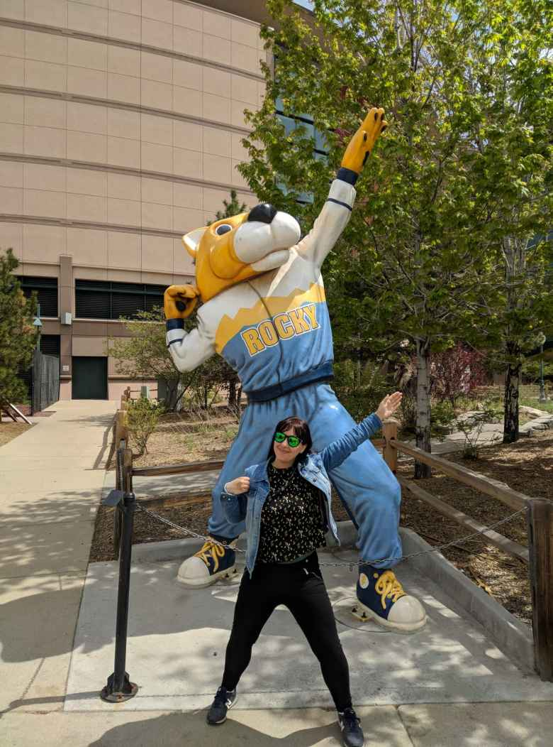 Vicky with the Rocky mascot for the Denver Nuggets at the Pepsi Center.