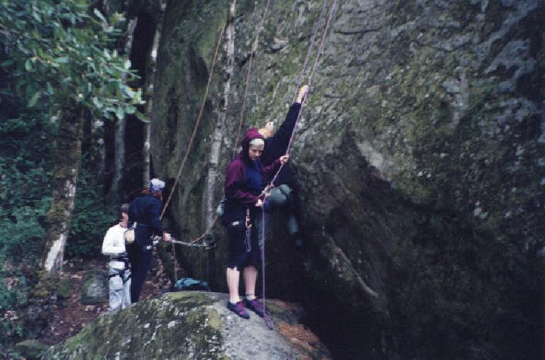 Charis belaying in the foreground and Tori belaying in the background.