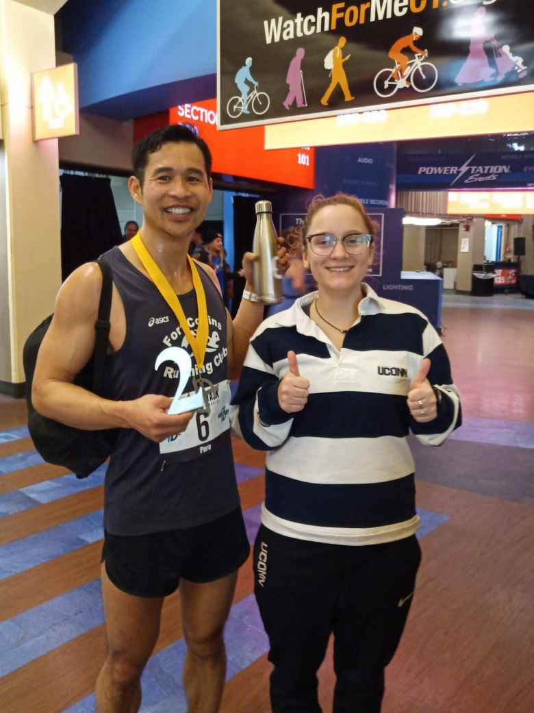 Felix Wong with a volunteer from the UConn lacrosse team, who filled his 16 ounce water bottle with Heed at least 5X!