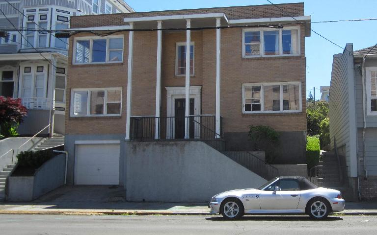 silver 2000 BMW Z3 2.3, brown house, Astoria, Oregon