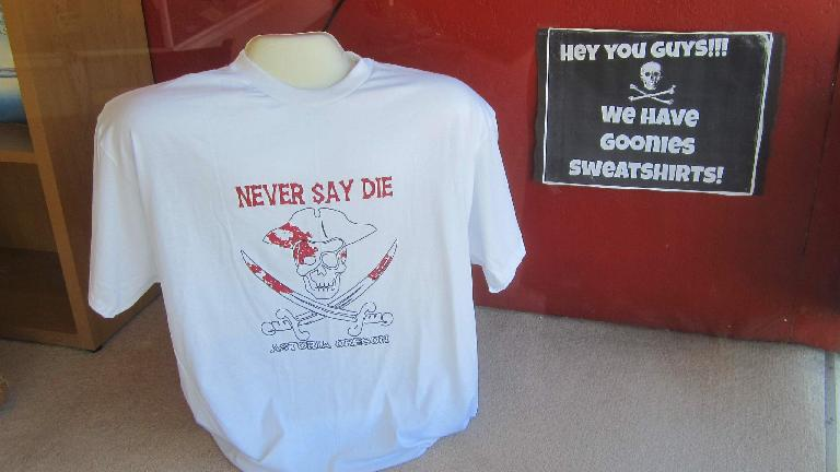 white Never Say Die T-shirt, Hey You Guys We Have Goonies Sweatshirts sign, Astoria, Oregon