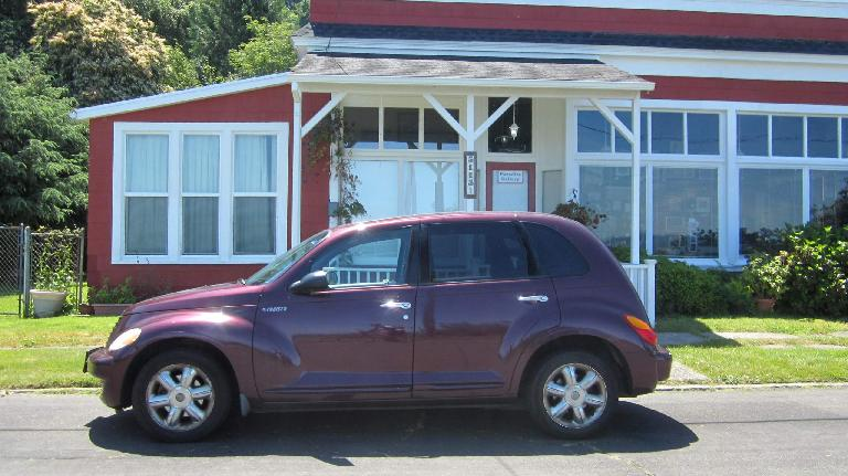 purple Chrysler PT Cruiser, red and white building, Paradise Gallery, Astoria, Oregon