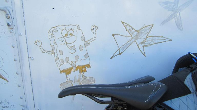 SpongeBob SquarePants drawing on white panel, Specialized Romin Evo Pro saddle