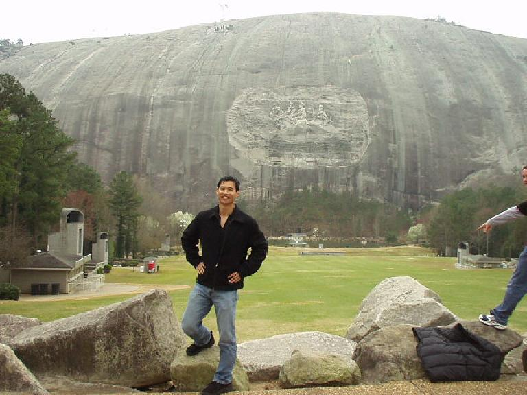 Felix Wong in front of the carving of Stonewall Jackson, Robert E. Lee and Jefferson Davis, which is supposedly 3X larger than the carving in Mt. Rushmore.