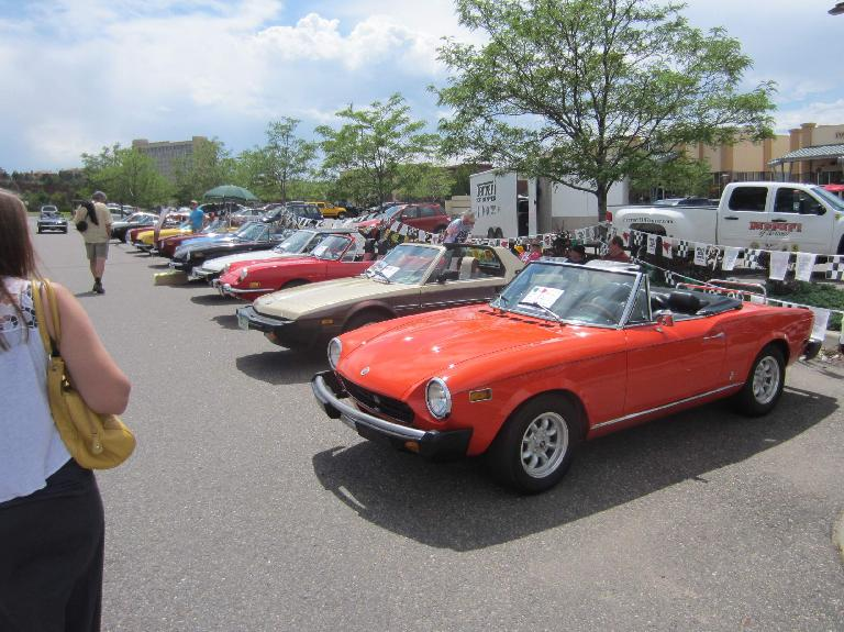 The Fiats, including the orange-red  Spider next to the Bertone-designed X1/9.