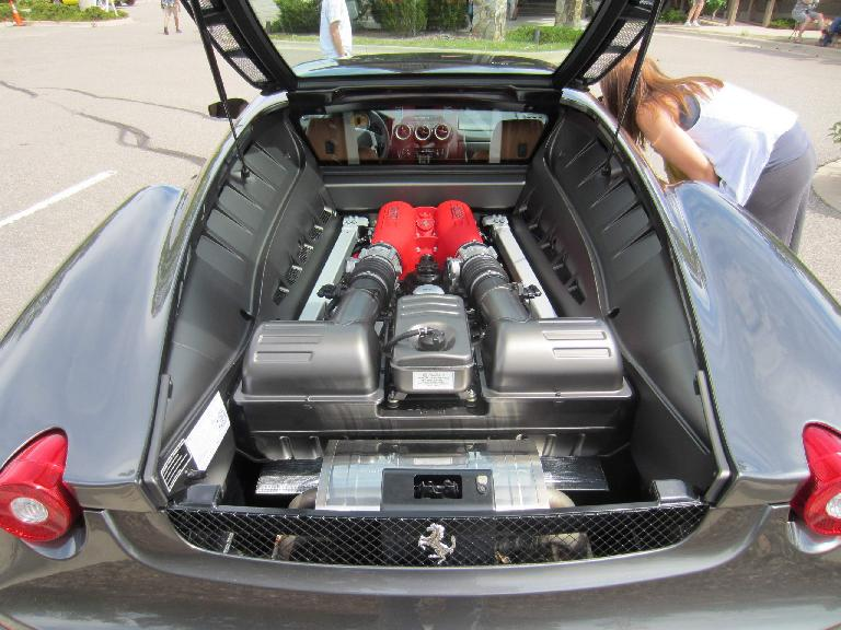 Kelly checks out the interior of the Ferrari 360 Modena while I check out the V8 engine and Testarossa intake covers.