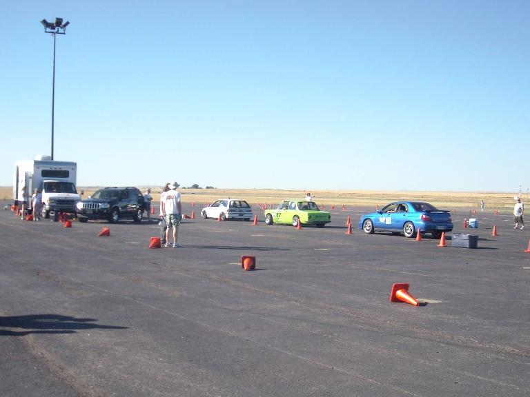 Cars begin to line up for their first runs.