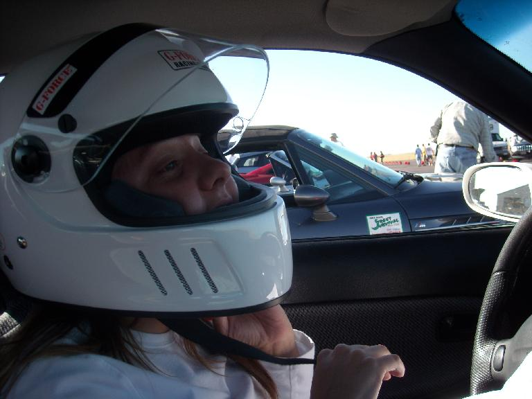 Kelly putting on her helmet.