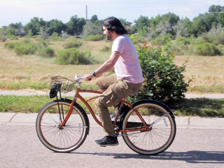 man in pink shirt, Huffy Cranbrook cruiser bike