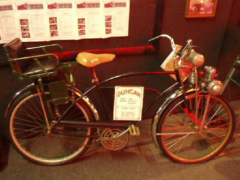 """Here's an early-20th century Duncan bicycle with a gasoline motor driving the front wheel and supposedly """"too dangerous""""."""