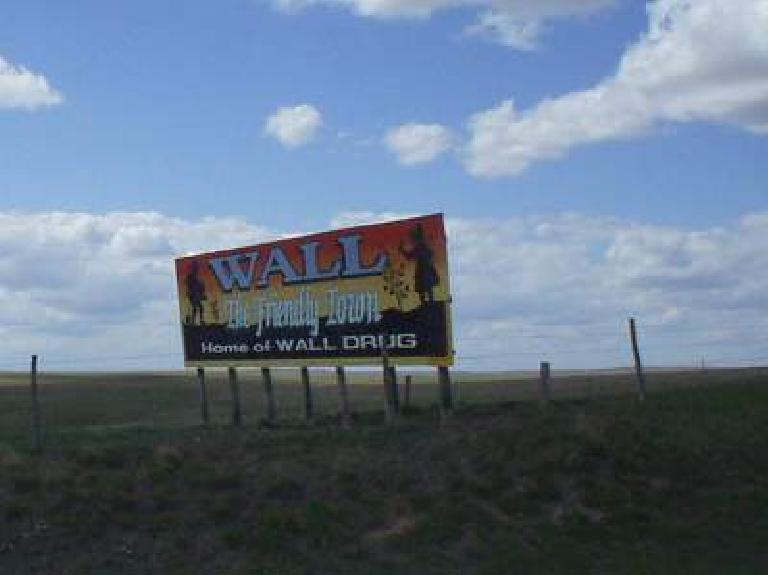 [Mile 94, 2:00pm] One of the many Wall Drug billboards outside of the Badlands National Park.