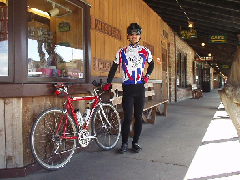 [Mile 103, 2:41pm] Canny & Felix Wong at the front of Wall Drug, which had a cafe and souvenir shop.