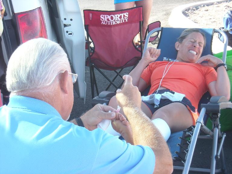John the foot doctor injecting zinc oxide to help dry a blister on the underside of Alene's left foot. (July 12, 2011)