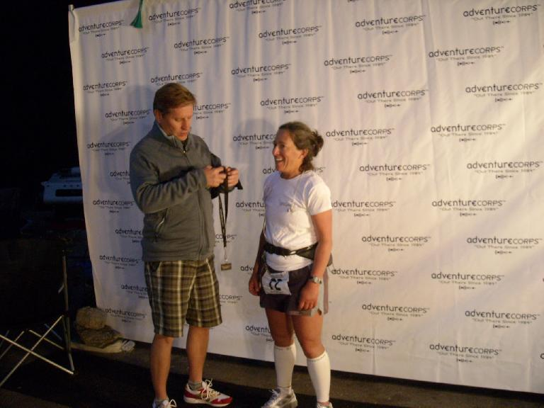 Badwater race director Chris Kostman presenting a finisher's medal to Alene. (July 13, 2011)