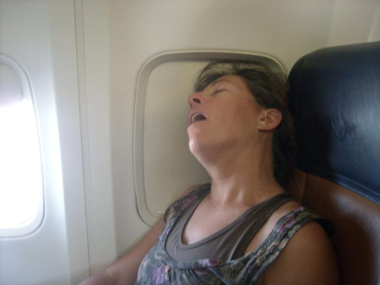Alene got some much-needed rest on the plane back to Denver. (July 17, 2011)