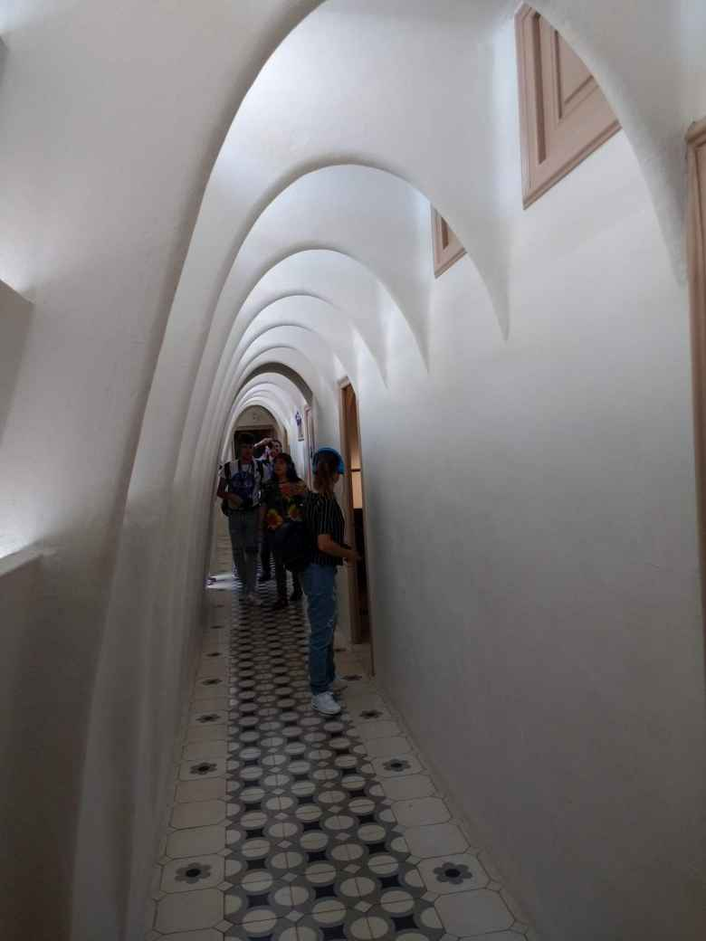 Hallway in Casa Balló, with white archways.