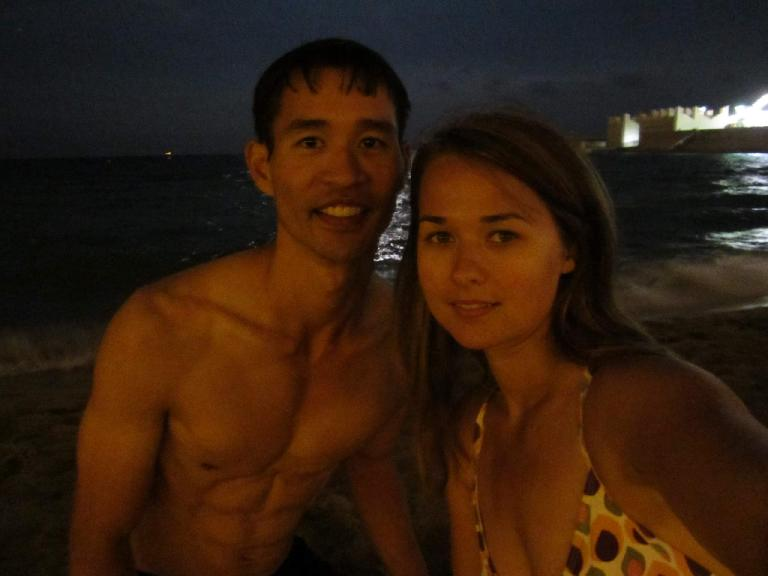 Felix Wong and Katia on the beach at night.
