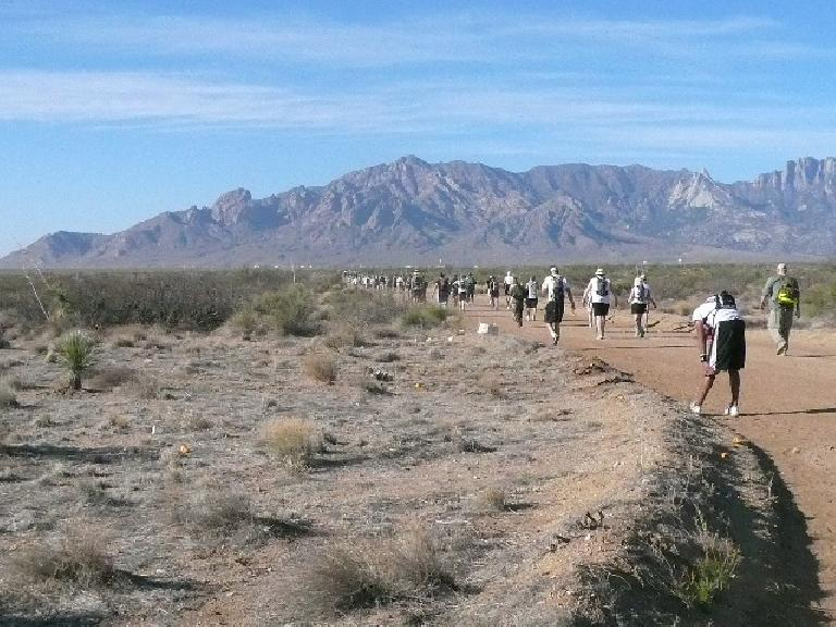 Mile 7: A runner stretches with a nice view of the mountains ahead.