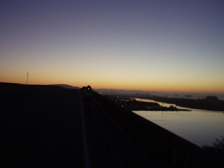 [Mile 7, 5:43 a.m.] As the sun took a peak over the horizon, I followed AJ across the shoulderless Petaluma Bridge on CA-37.  This would be just one of the several highways we'd have to ride on.