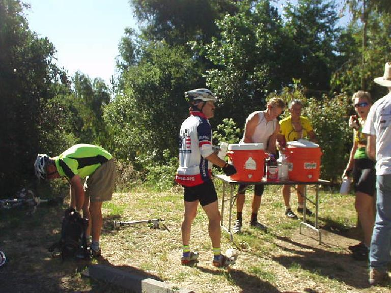 [Mile 52, 9:15 a.m.] At Rest Stop #2--Sibley Picnic Area--Joseph Maurer (wearing the RUSA jersey) and AJ fill their bottles/Camelback.  Water would become a precious commodity later in the day!
