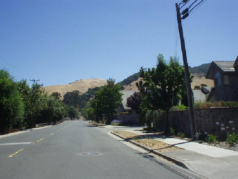 [Mile 85, 11:41 a.m.] Now off of traffic-laden Mission Blvd. and into Fremont, one gets a view of the top of Morrison Canyon Rd.--a familiar training grounds for me, having done many hill repeats up its 750' in 1.75 miles.  Fortunately we did not have to go up it today!