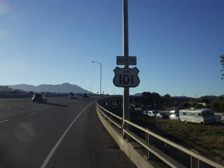 [Mile 166, 7:08 p.m.] Another mile, another highway.  This is US-101 over the Richardson Bay Bridge.