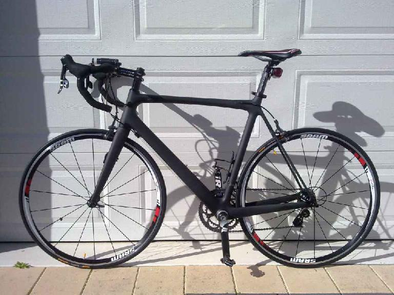 A open-mold Chinese carbon bike painted matte black. Photo: RoadBikeReview.com forums.