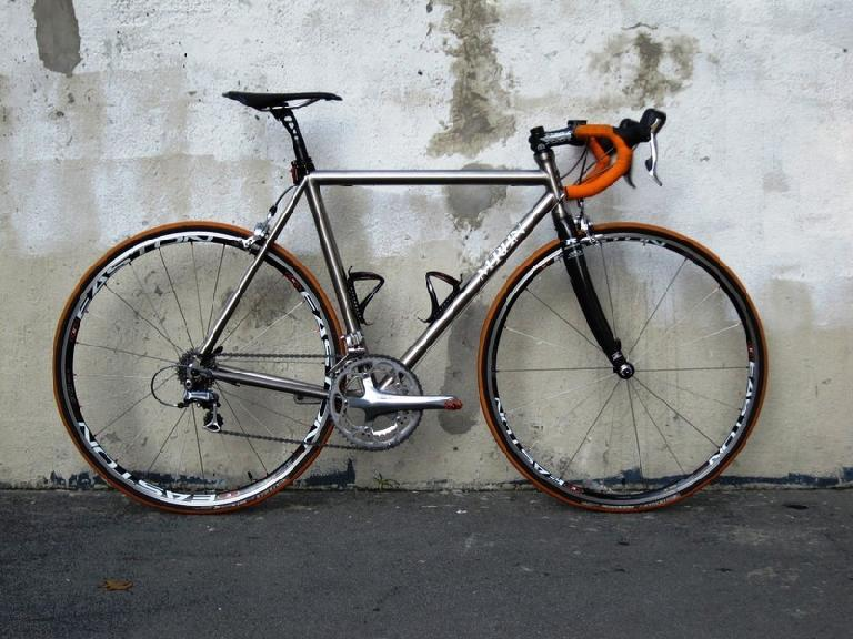 Titanium Merlin with orange handlebar tape.