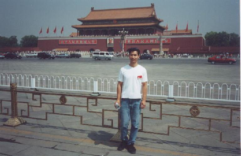 Felix Wong in Tiananmen Square overlooked by a portrait of Chairman Mao.  No I did not buy any Mao watches!