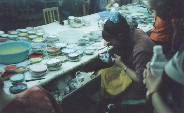 Handcrafting cloisonne at a cloisonne factory. (May 28, 2002)