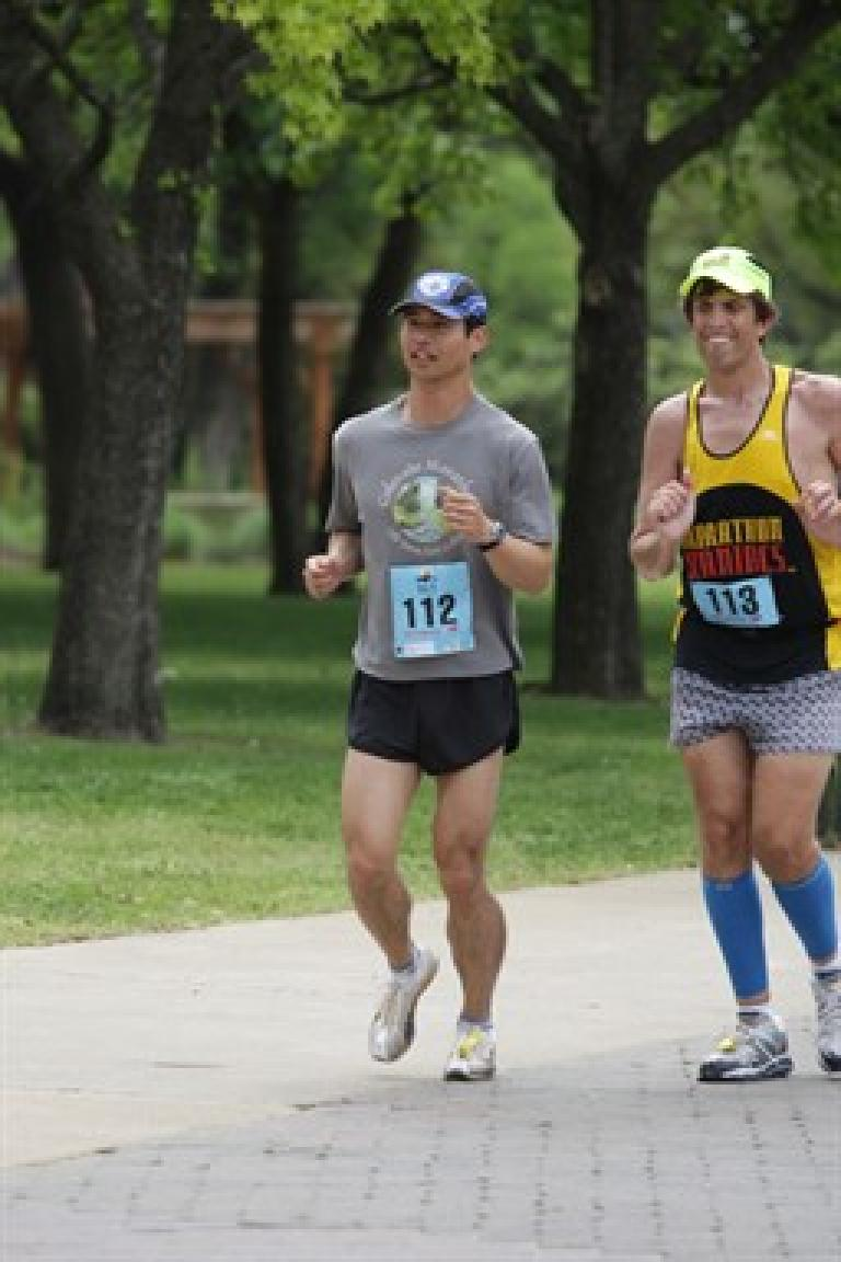 Felix Wong and Dan running by a park in the Big-D Texas Marathon. Photo: Brightroom Event Photography.