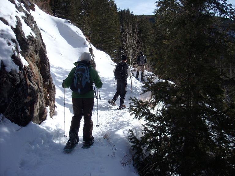 Tori, Felix Wong and Rob stomping through the snow.