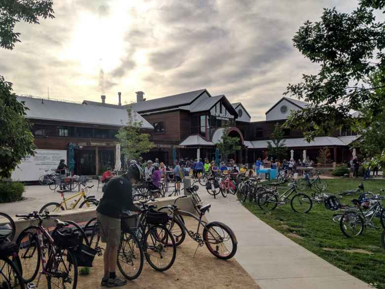 There were lots of people and bikes at the New Belgium Brewery station.