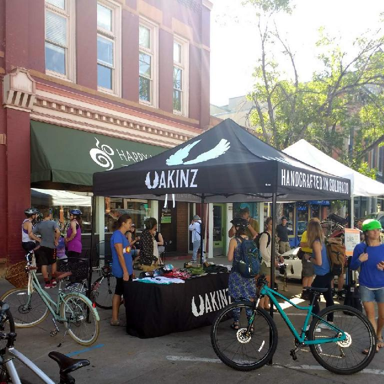 The Fort Collins Bike to Work Day station, in front of Happy Lucky's Tea House.  Akinz clothing and the Fort Collins Bike Co-op staffed it.