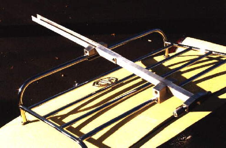 My custom bike rack mounted on the luggage rack of my 1969 MGB.