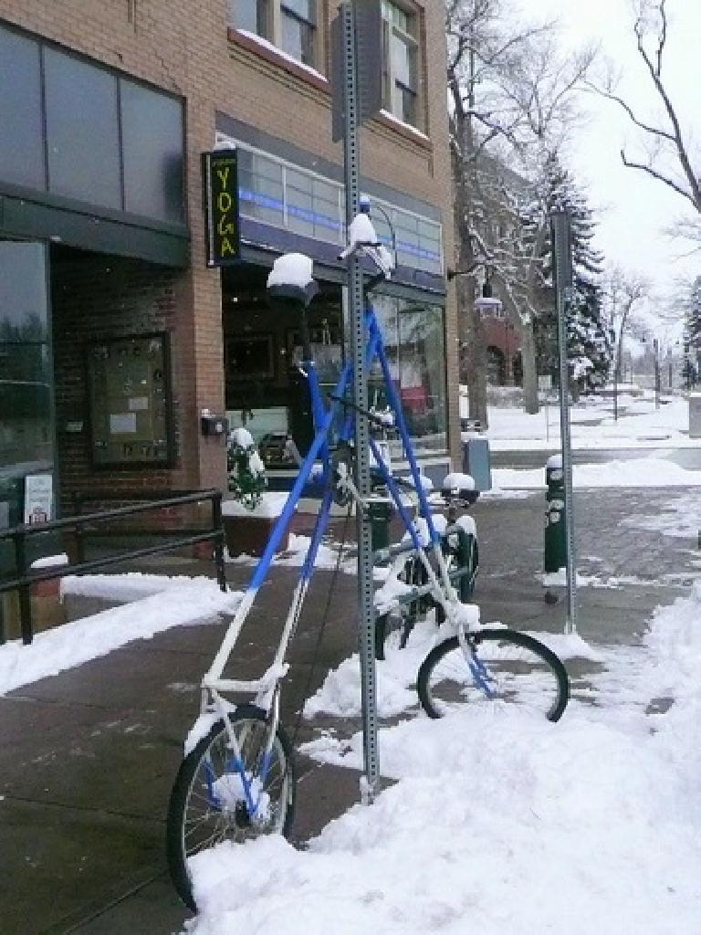 Not a bike rack per se, but what the owner of this tall bike locked it up to on a December day outside Bikram Yoga. (December 11, 2007)