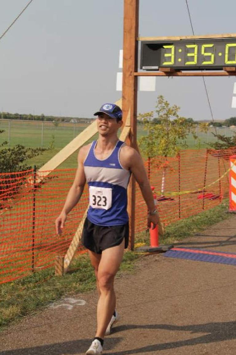Considering all that occurred in the final miles of the race, I looked (and was) really happy to cross the finish line of the Bismarck Marathon. Photo: BobsPhoto.com.