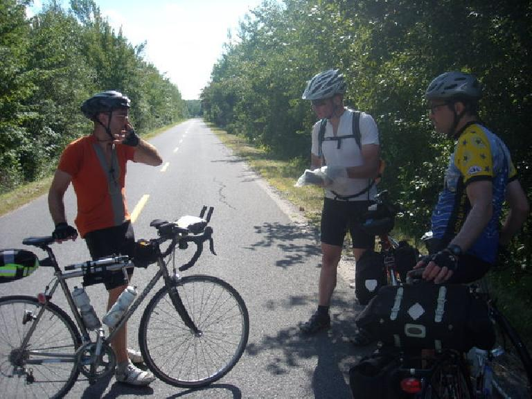 [Mile 361] We encoutered Anthony (on the left) who was on his way back to the Boston.  Moments before this, he flew over his handlebars into a tree and some grass, cracking his helmet but sustaining no injuries. (August 12, 2011)
