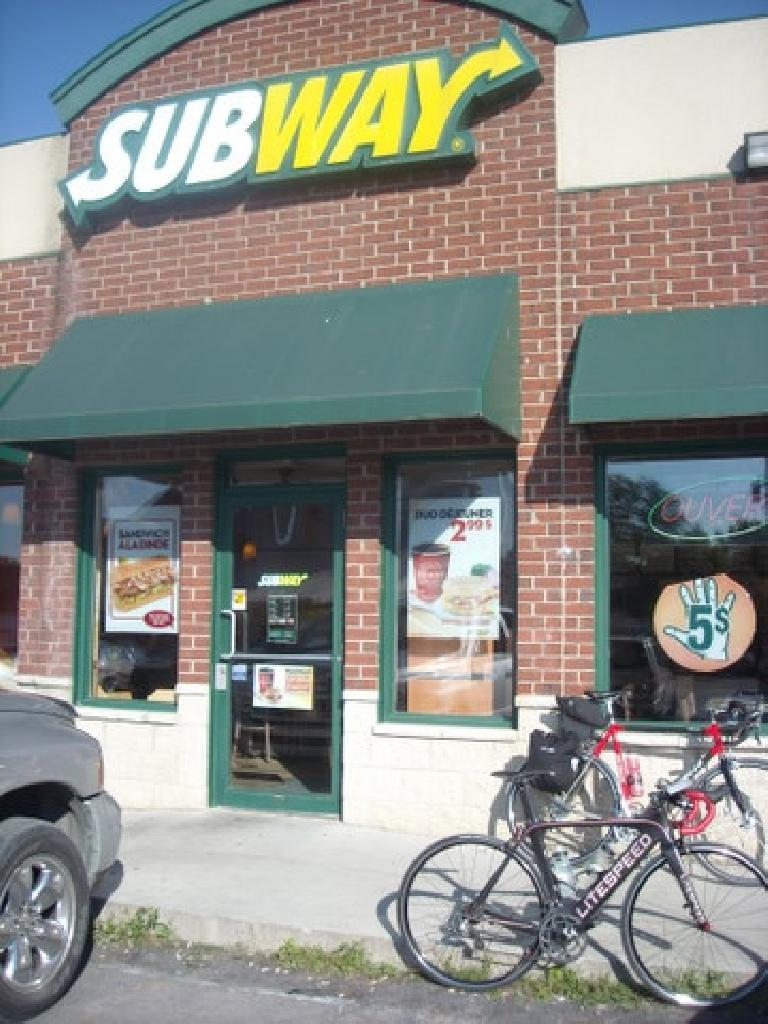 [Mile 376] Made it to the turnaround---and halfway point---at this Subway in Huntingdon, Canada, where I ordered a sandwich in French. (August 12, 2011)