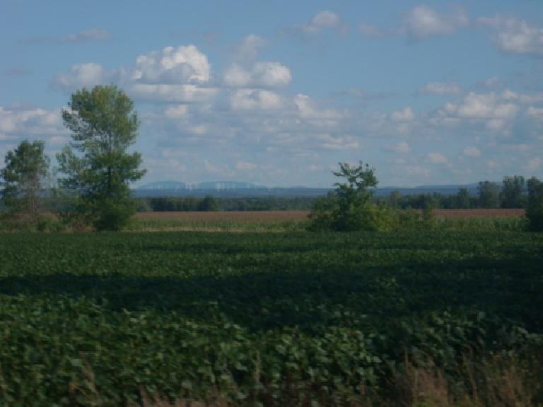 [Mile 379] Beyond the farmland, a windmill farm in Quebec was visible in the distance. (August 12, 2011)