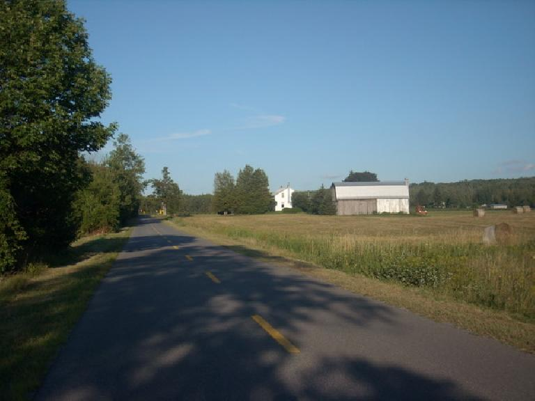 [Mile 392] Riding past more farms in the province of Quebec. (August 12, 2011)