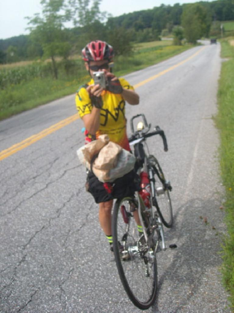 [Mile 517] I ran into Susan---the organizer of this year's mass-start BMB Permanent---on the way to Middlebury, Vermont. She was sick the first couple days, she was still on her way out to Montreal at Mile 236. (August 13, 2011)