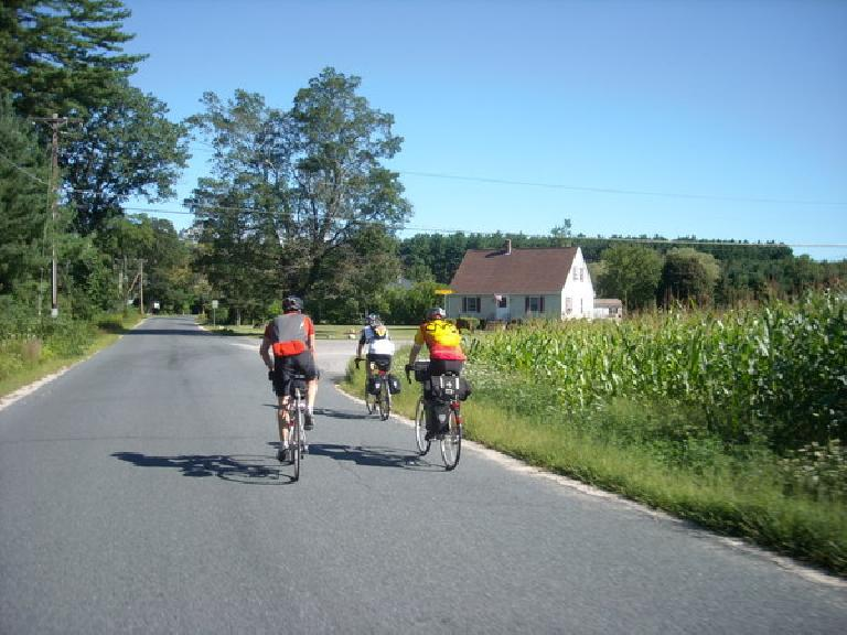 [Mile ~77] Riding past corn fields with Anthony, Ted, and Chip not far from the border of New Hampshire.