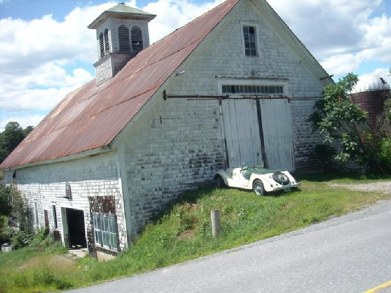 [Mile ~126] A Morgan in front of an old barn in Vermont.