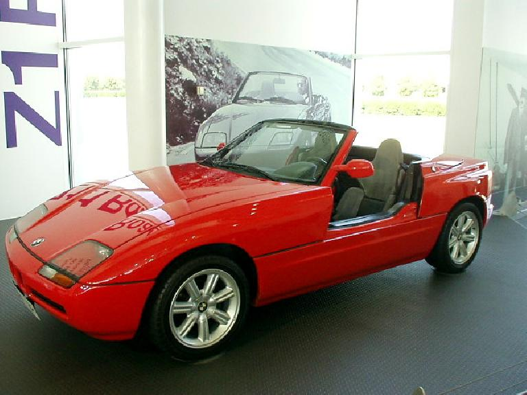 "This is a 1989 BMW Z1 roadster (which started the ""Z"" designation for BMW roadsters).  Its distinctive feature were doors that retracted downward into the body work to allow egress and ingress."