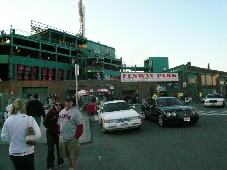 Fenway Park with a Bentley idling in front.