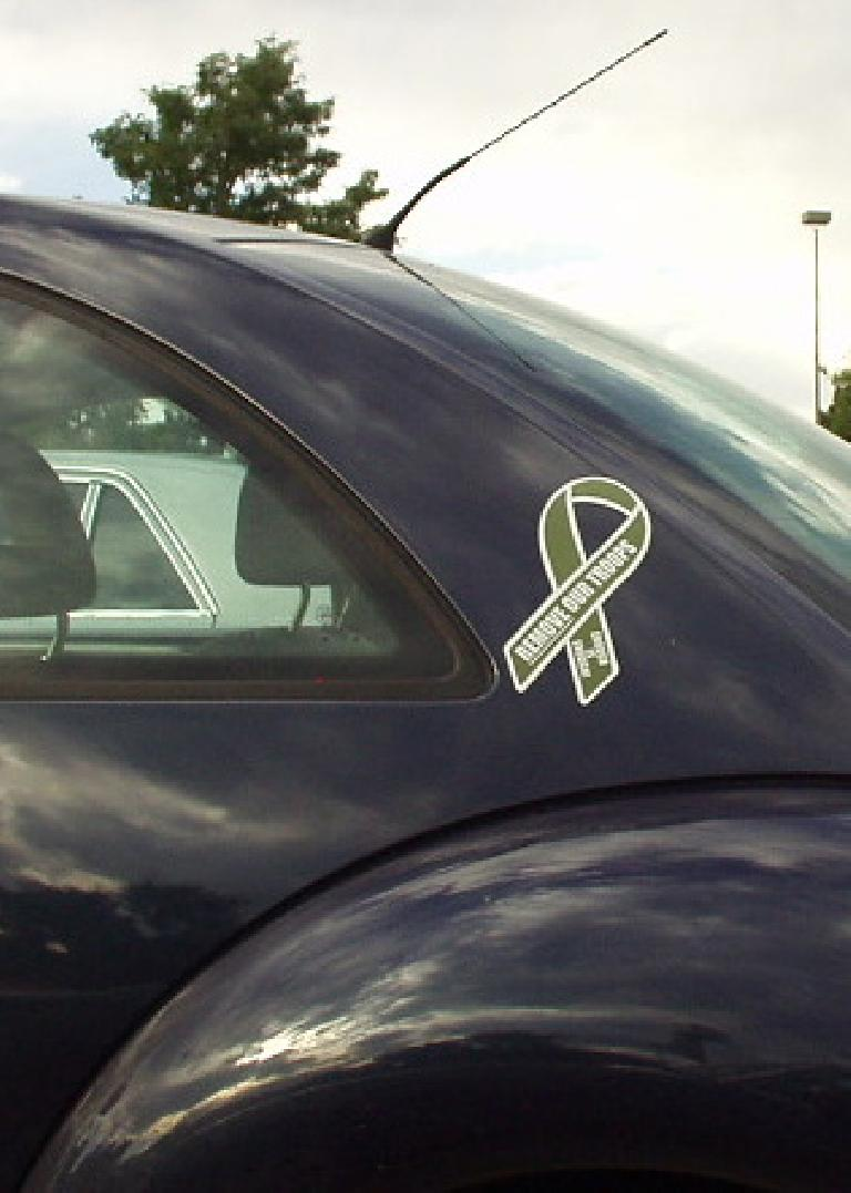 """Boulder is a bastion of liberalism.  A VW Beetle with a ribbon saying """"REMOVE our troops""""."""