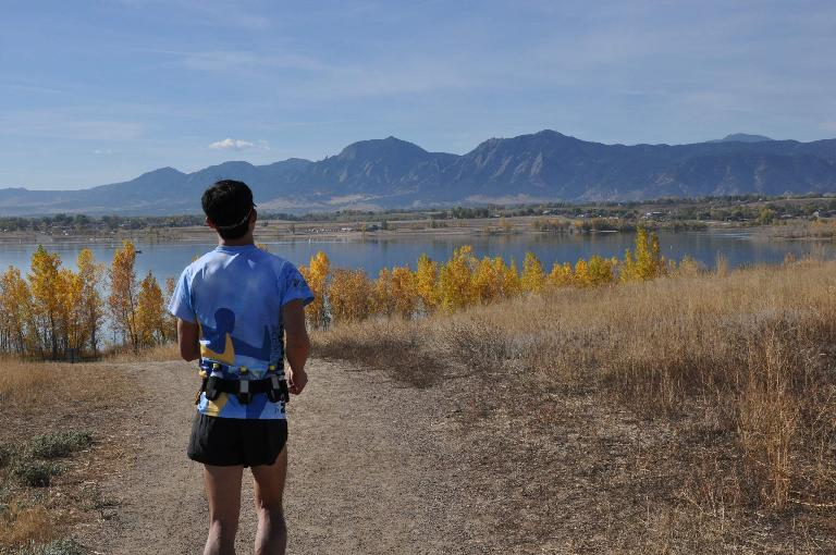 [Mile 96.5, 10:32a] Running back towards the Boulder Reservoir, golden aspens and iconic Flatirons for one last time. Photo: Eddie Metro.