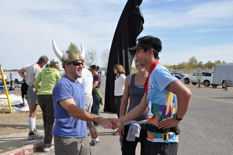 [Mile 100, 11:57 a.m.] Finally, FINISHED!  Being congratulated by the Viking race director. It took me 26hrs 57min to go 100 miles, including zero sleep. Photo: Eddie Metro.